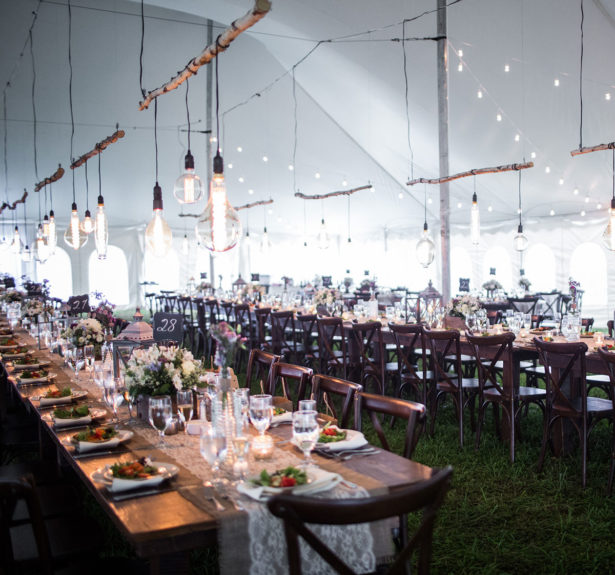 long wedding tables inside wedding tents